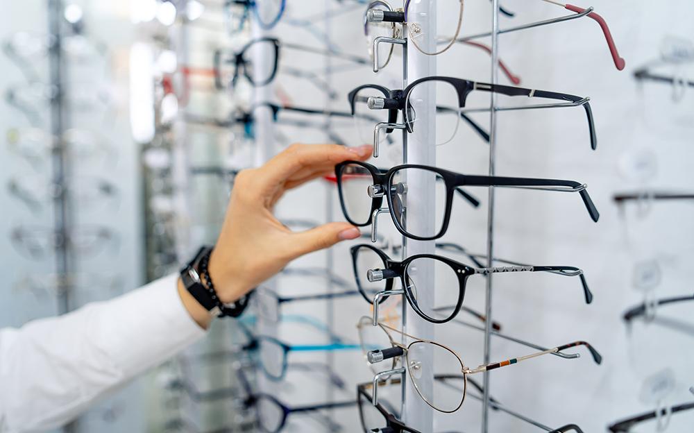 Optometrist reaching for glasses